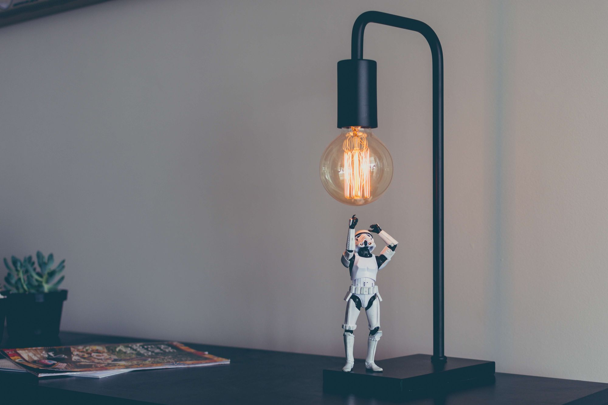 Stormtrooper trying to touch a light bulb