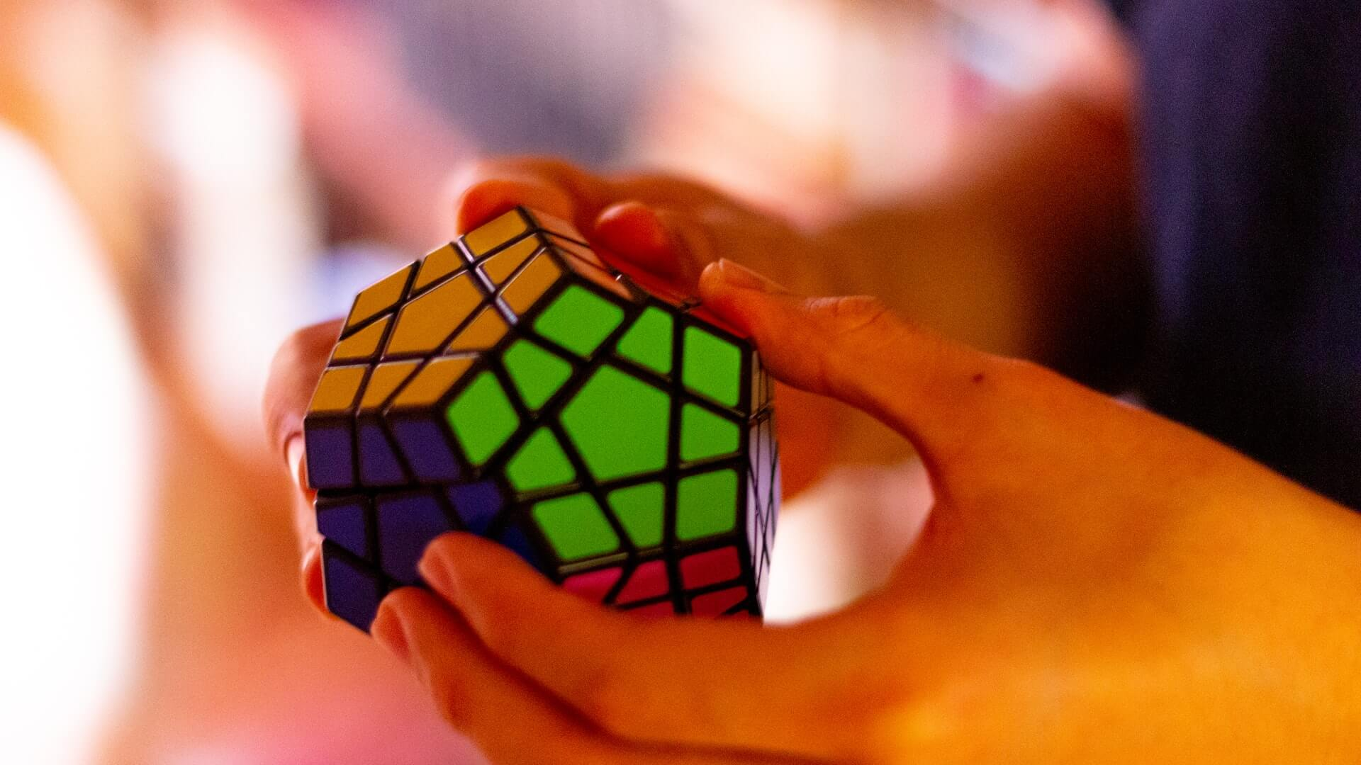 Hands holding a rubix puzzle