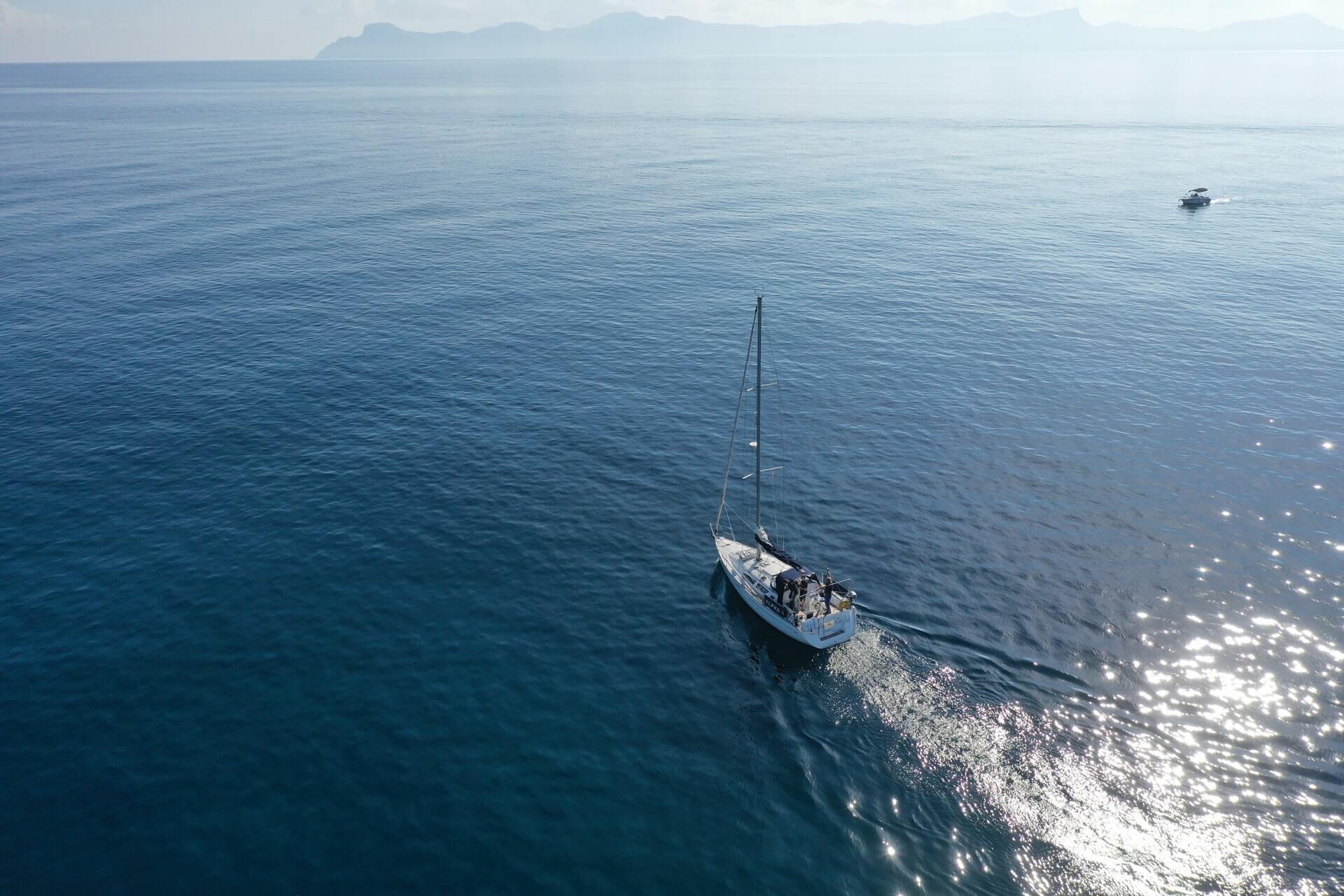 A sailboat crossing an ocean