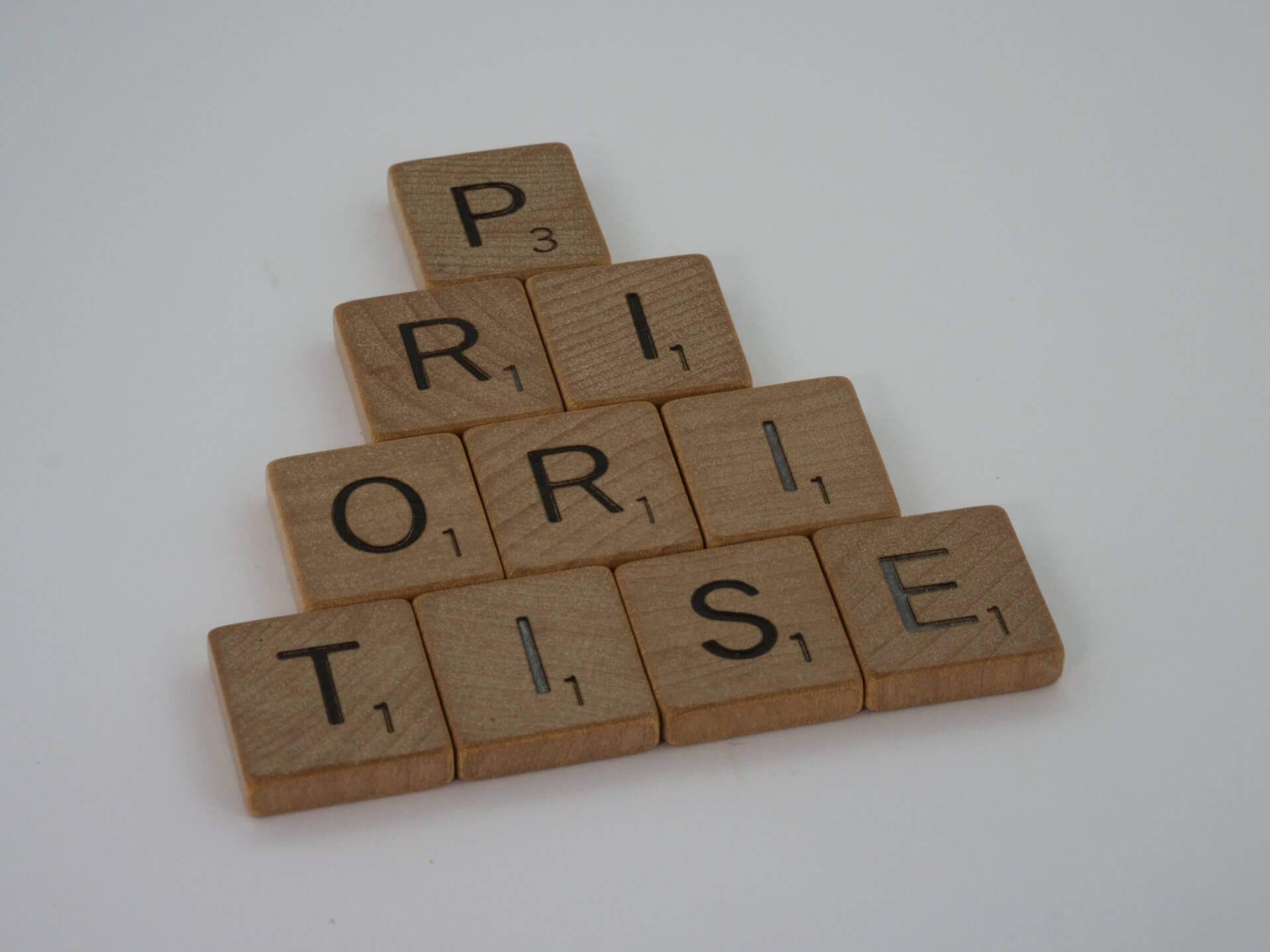 """wooden blocks with letters on, spelling out """"prioritise"""""""