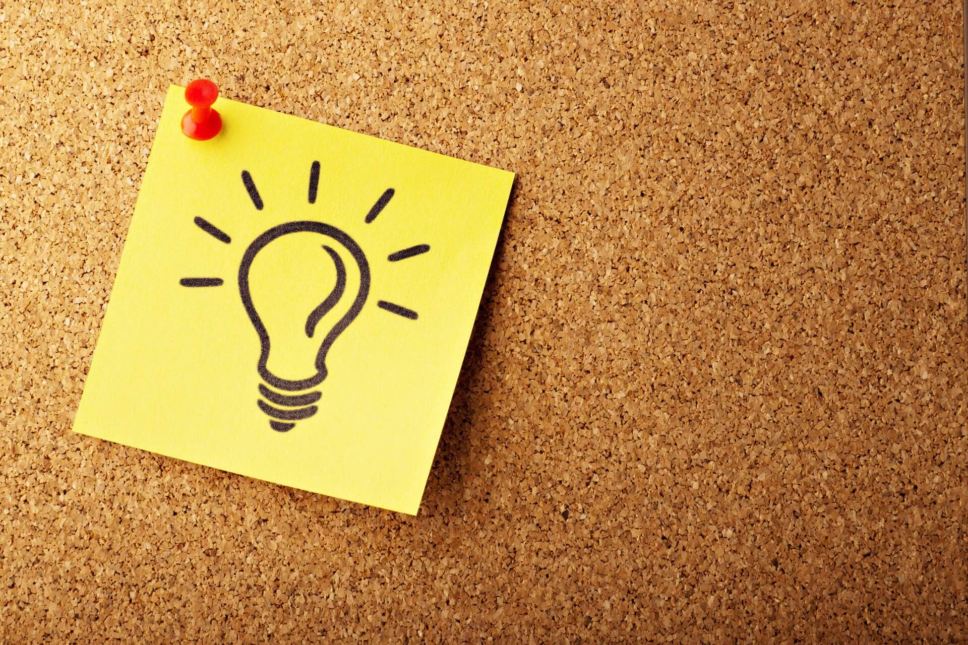 Sticky note with a drawing of a light bulb