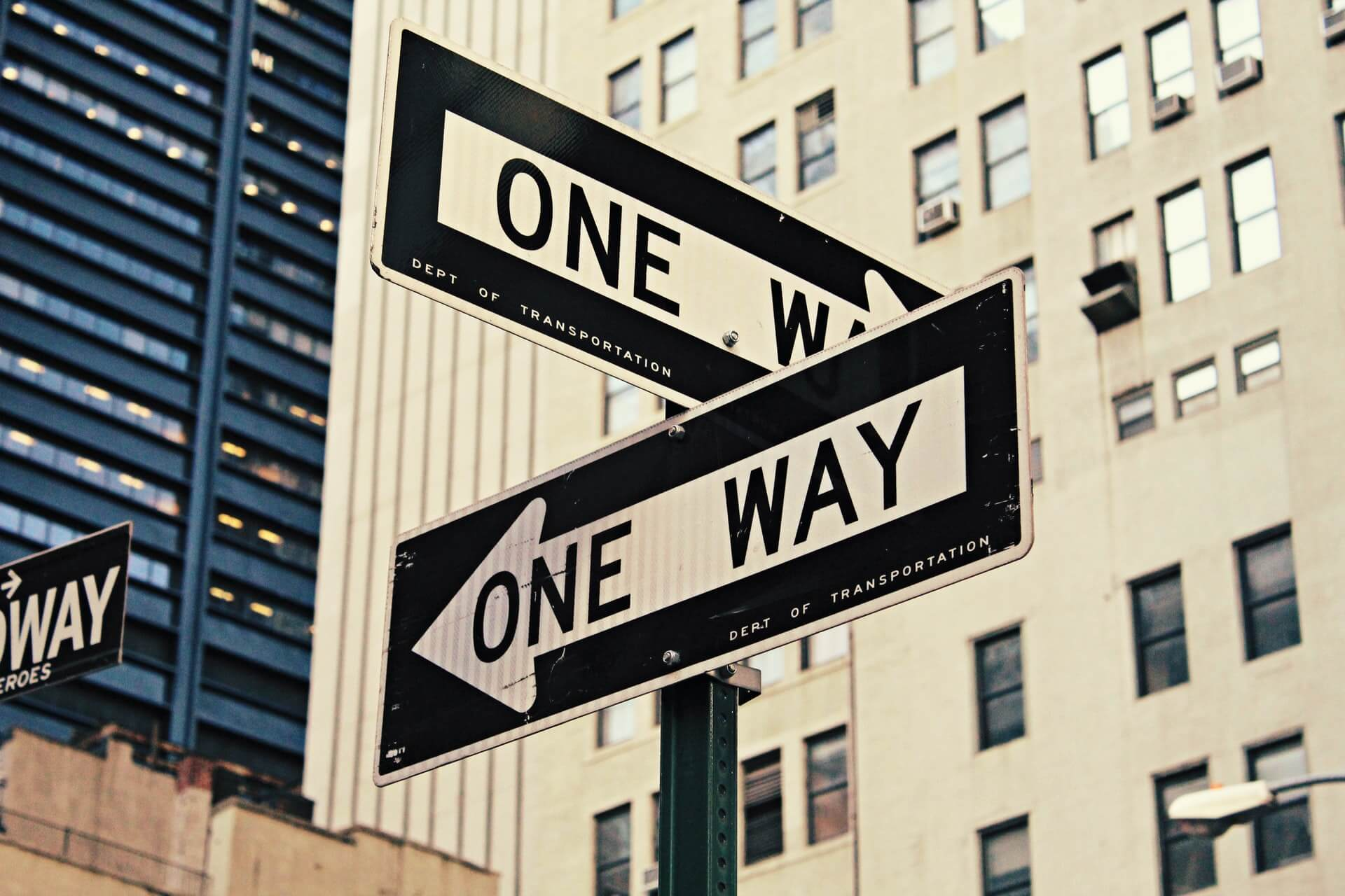 Street signs showing one way