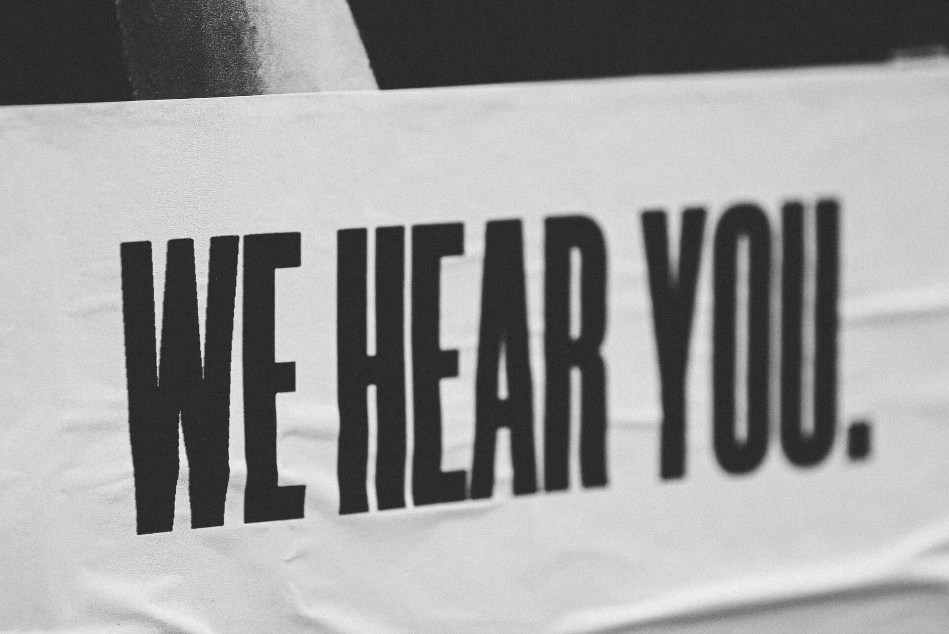 """Sign saying """"We hear you"""""""