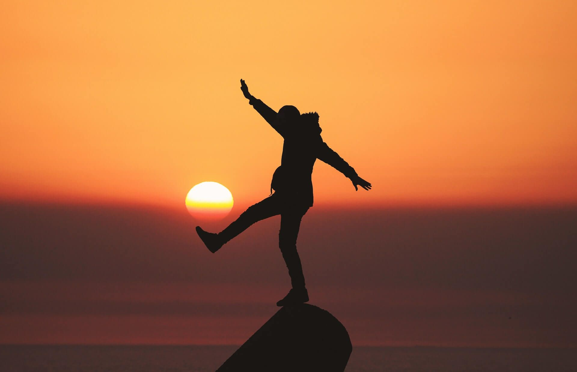 Person balancing on a rock